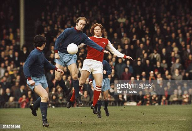 Paul Fletcher looks on as Peter Noble of Burnley challenges Alan Ball of Arsenal during a First Division match at Highbury on February 2nd 1974 in...