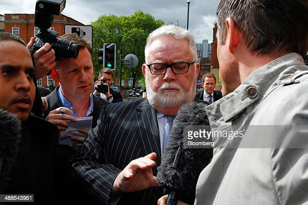 Paul Flowers former chairman of CoOperative Bank Plc center is surrounded by media as he leaves Leeds Magistrates Court in Leeds UK on Wednesday May...