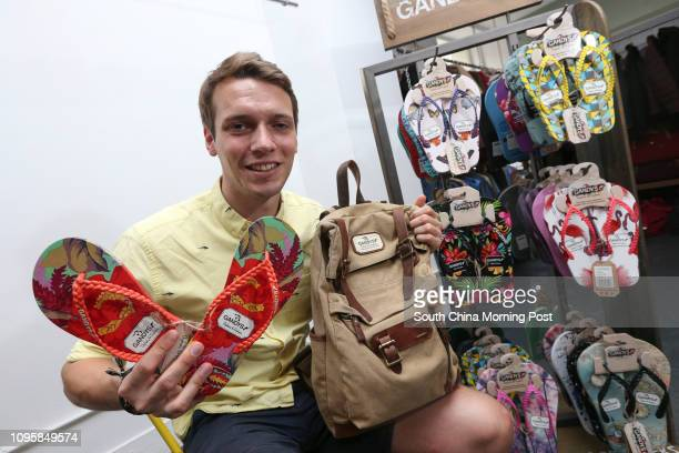 Paul Forkan and his Gandys Labelled products flipflops and a backpack at Ssure Step Brands Limited in Wong Chuk Hang Brothers Rob and Paul Forkan...