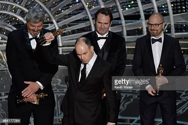 Paul Franklin accepts the Best Visual Effects Award for 'Interstellar' onstage with Andrew Lockley Ian Hunter Scott R Fisher during the 87th Annual...
