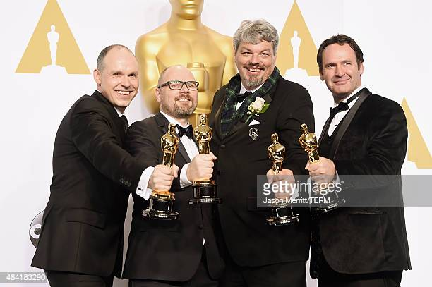 Paul Franklin, Scott R. Fisher, Andrew Lockley, and Ian Hunter, winners of the Best Visual Effects Award for 'Interstellar' pose in the press room...