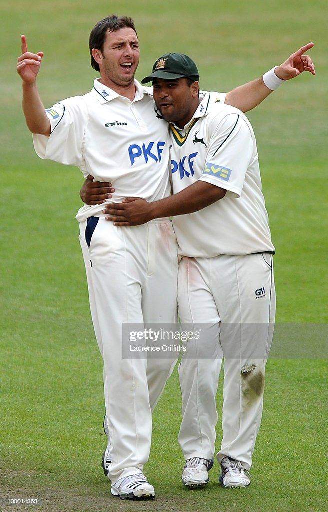 Paul Franks of Nottinghamshire is congratulated by Samit Patel on the wicket of James Vince of Hampshire during the LV County Championship match between Nottinghamshire and Hampshire at Trent Bridge on May 20, 2010 in Nottingham, England.