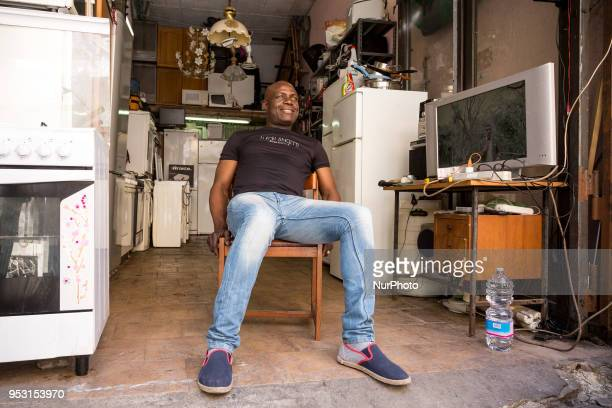 Paul from Nigeria runs secend hand goods shop in Ballaro market in Palermo Sicily on April 25 2018 For decades migrants from black Africa arrive to...