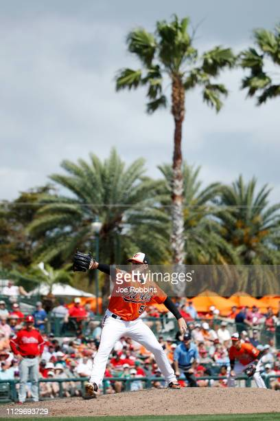 Paul Fry of the Baltimore Orioles pitches in the sixth inning of a Grapefruit League spring training game against the Philadelphia Phillies at Ed...