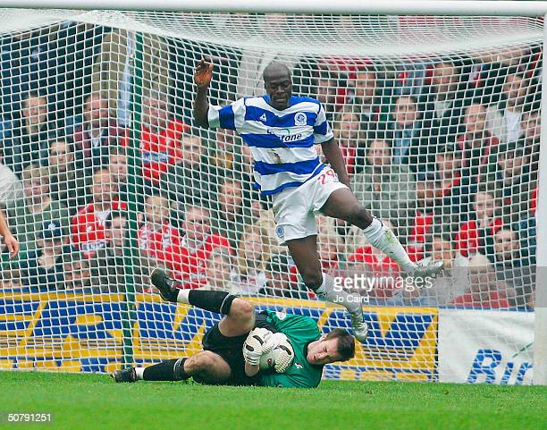 Paul Furlong leaps over Rhys Evans during the Nationwide Division Two match between Queens Park Rangers and Swindon Town at Loftus Road on May 1,...