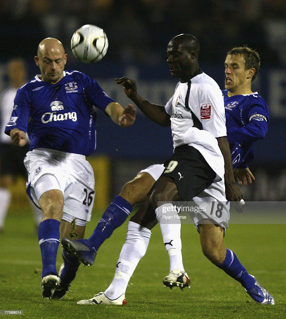 Paul Furlong (C) of Luton Town is tackled by Lee Carsley (L) and Phil Neville (R) of Everton during the Carling Cup Fourth Round match between Luton Town and Everton at Kenilworth Road on October 31, 2007 in Luton, United Kingdom.