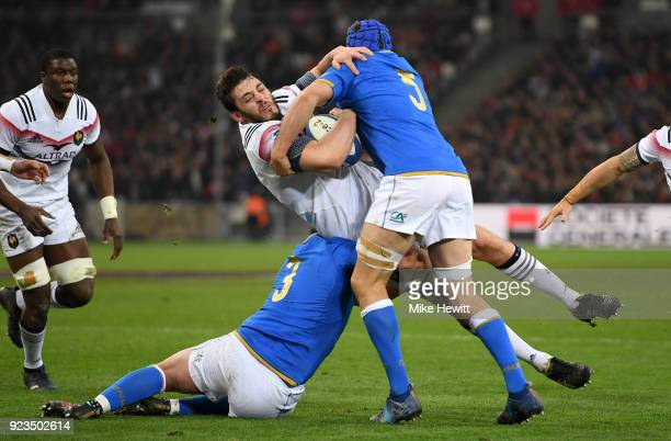 Paul Gabrillagues of France is tackled by Dean Budd and Simone Ferrari of Italy during the NatWest Six Nations match between France and Italy at...