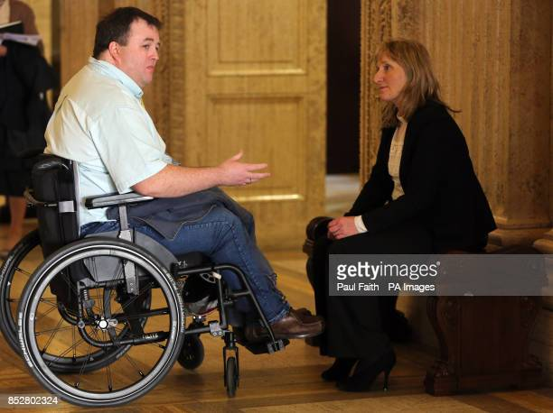 Paul Gallagher Chairman of the Victims and Survivors' Trust speaks with colleague Sandra Peake at Parliament buildings Stormont as a report from the...