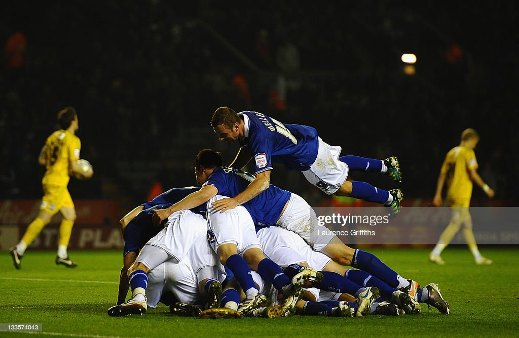 Paul Gallagher of Leicester City is mobbed after scoring the second goal with David Nugent and Jermaine Beckford during the npower Championship match between Leicester City and Crystal Palace at Walkers Stadium on November 20, 2011 in Leicester, England.