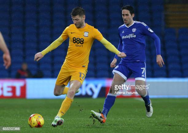 Paul Gallagher of Preston North End is closely marked by Peter Whittingham of Cardiff City during the Sky Bet Championship match between Cardiff City...