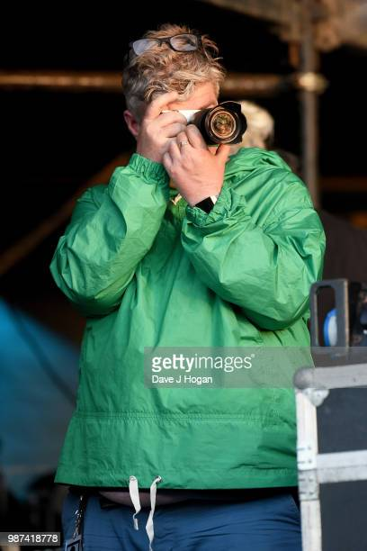 Paul Gallagher photographs the crowd during Liam Gallagher at Finsbury Park on June 29 2018 in London England