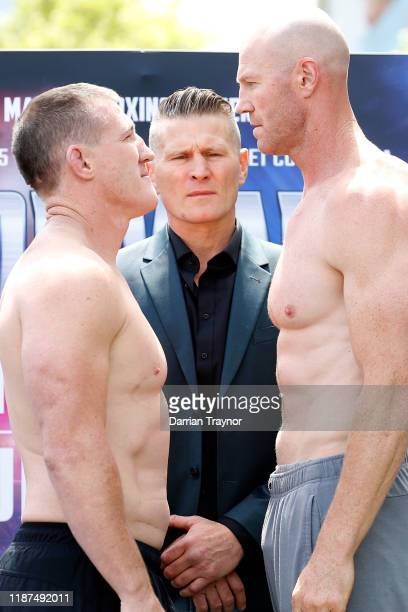 Paul Gallen and Barry Hall face off as Danny Green looks on during the Barry Hall v Paul Gallen press conference at the Crown Promenade on November...