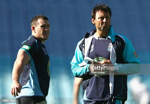 Paul Gallen and Blues coach Laurie Daley look on during a New South Wales Blues state of origin training session at ANZ Stadium on June 4 2013 in...