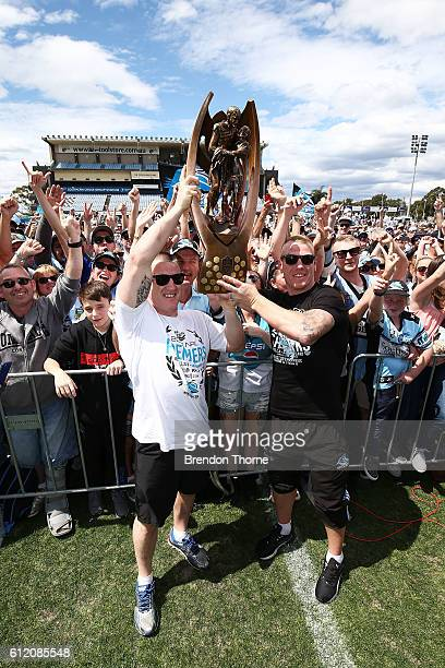 Paul Gallen and Luke Lewis of the Sharks hold aloft the Premiership Trophy after winning the 2016 NRL Grand Final during the Cronulla Sharks NRL...