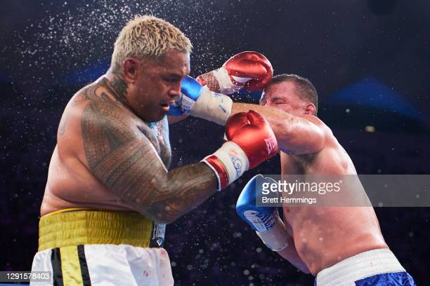 Paul Gallen and Mark Hunt compete during the Main Event fight prior to the light-middleweight World Title elimination bout between Tim Tszyu and...