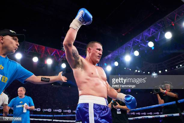 Paul Gallen celebrates victory over Mark Hunt during the Main Event fight prior to the light-middleweight World Title elimination bout between Tim...