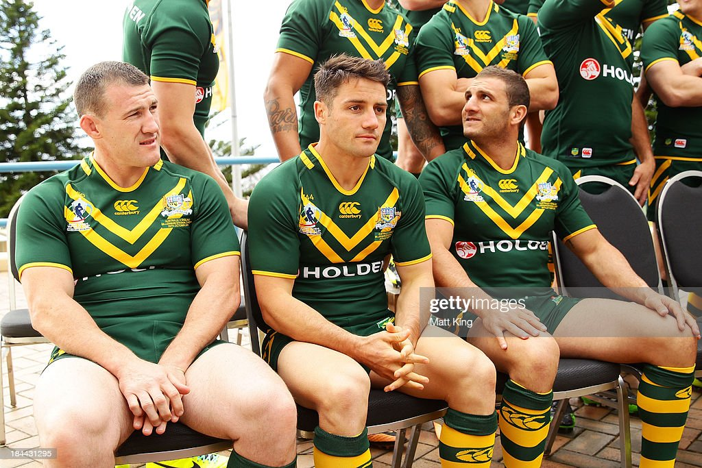 Paul Gallen, Cooper Cronk and Robbie Farah wait during an Australian Kangaroos Rugby League World Cup teamphoto session at Crowne Plaza, Coogee on October 14, 2013 in Sydney, Australia.