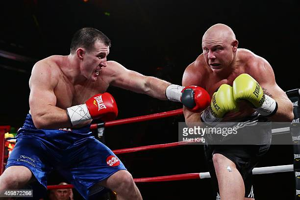 Paul Gallen fights Anthony Watts during the heavyweight bout between Paul Gallen and Anthony Watts at Hordern Pavilion on December 3, 2014 in Sydney,...