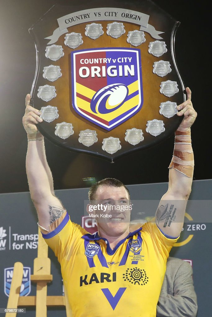 Paul Gallen of City celebrates with the shield after victory during the 2017 City versus Country Origin match at Glen Willow Sports Ground on May 7, 2017 in Mudgee, Australia.