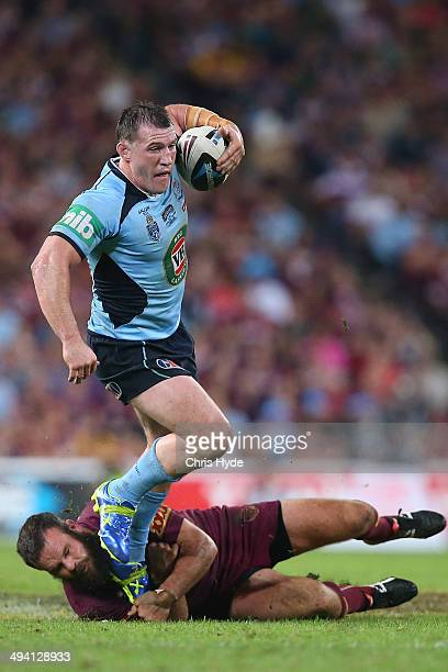 Paul Gallen of the Blues breaks through the defence of Nate Myles of the Maroons during game one of the State of Origin series between the Queensland...