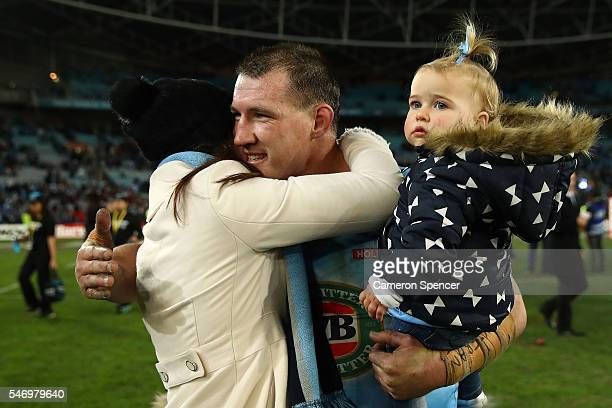 Paul Gallen of the Blues celebrates with his family after winning game three of the State Of Origin series between the New South Wales Blues and the...