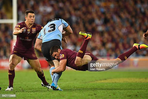 Paul Gallen of the Blues is tackled by Matt Gillett and Cooper Cronk of the Maroons during game two of the State Of Origin series between the...