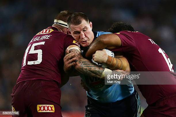Paul Gallen of the Blues is tackled during game one of the State Of Origin series between the New South Wales Blues and the Queensland Maroons at ANZ...