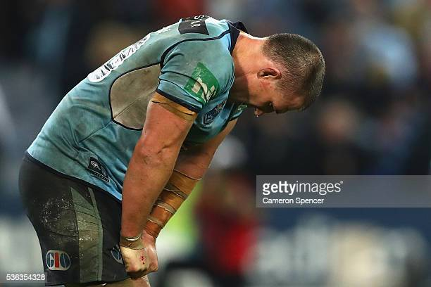 Paul Gallen of the Blues looks dejected after losing game one of the State Of Origin series between the New South Wales Blues and the Queensland...
