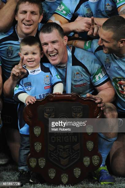 Paul Gallen of the Blues poses with his son Kody with the winners shield after game three of the State of Origin series between the Queensland...