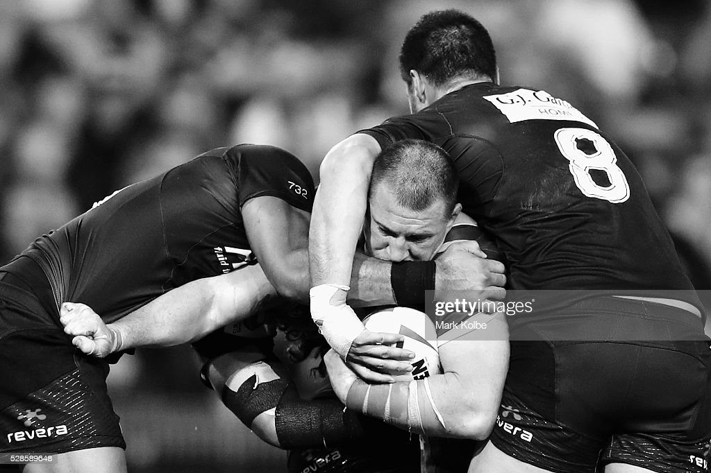 Paul Gallen of the Kanagroos is tackled during the International Rugby League Trans Tasman Test match between the Australian Kangaroos and the New Zealand Kiwis at Hunter Stadium on May 6, 2016 in Newcastle, Australia.