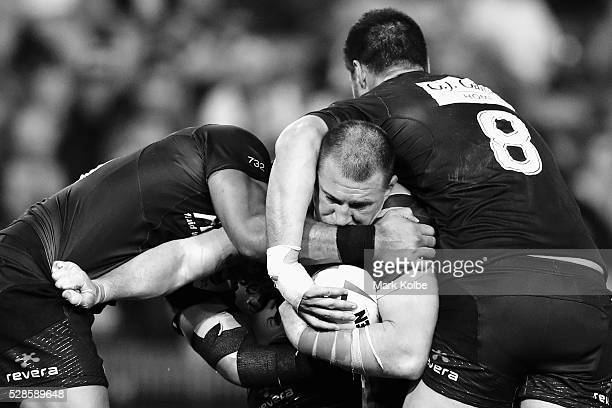 Paul Gallen of the Kanagroos is tackled during the International Rugby League Trans Tasman Test match between the Australian Kangaroos and the New...