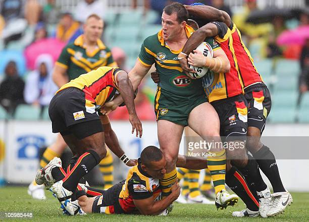Paul Gallen of the Kangaroos is tackled during the Four Nations match between the Australian Kangaroos and Papua New Guinea at Parramatta Stadium on...