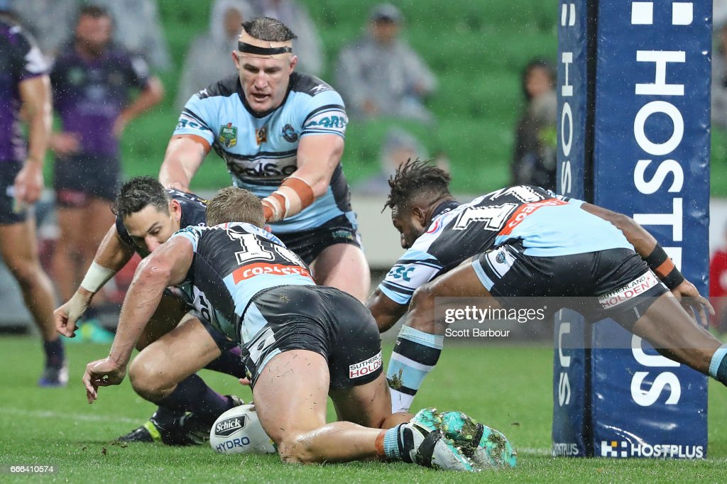 Paul Gallen of the Sharks and Matt Prior of the Sharks look on as James Segeyaro (R) of the Sharks scores the match-winning try as Billy Slater of the Melbourne Storm looks on during the round six NRL match between the Melbourne Storm and the Cronulla Sharks at AAMI Park on April 9, 2017 in Melbourne, Australia.