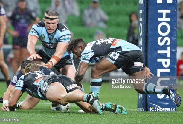 Paul Gallen of the Sharks and Matt Prior of the Sharks look on as James Segeyaro of the Sharks scores the matchwinning try as Billy Slater of the...