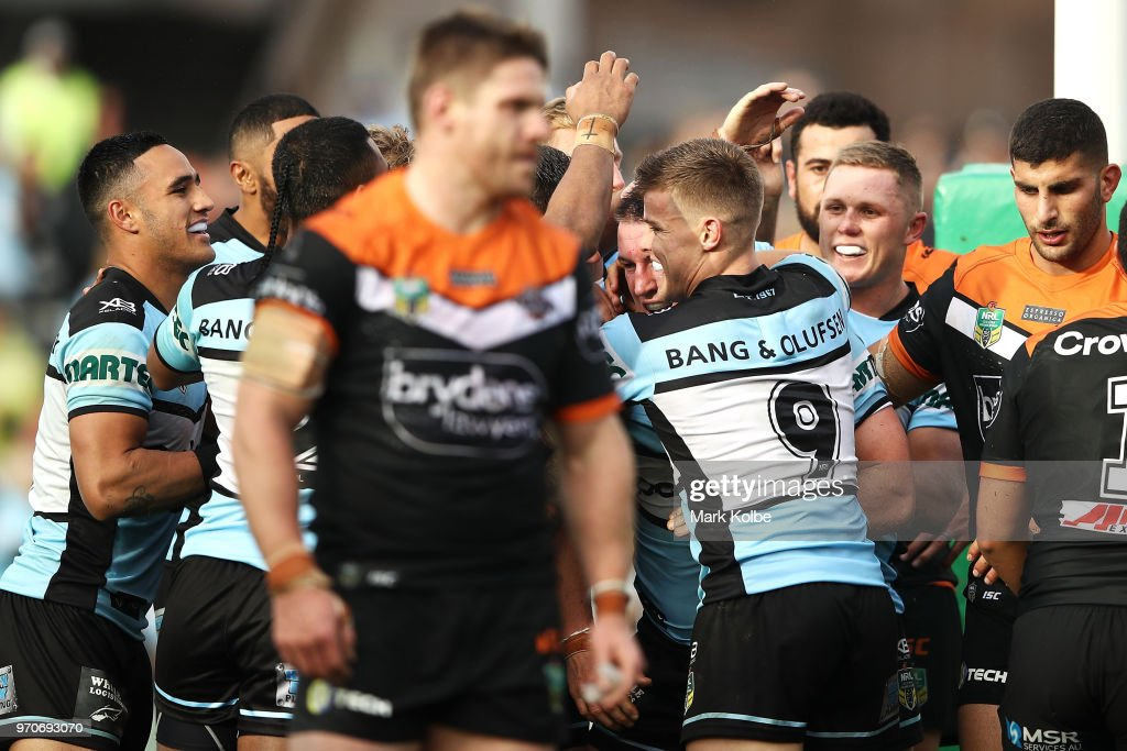 Paul Gallen of the Sharks celebrates with his team mates after scoring a try during the round 14 NRL match between the Cronulla Sharks and the Wests Tigers at Southern Cross Group Stadium on June 10, 2018 in Sydney, Australia.