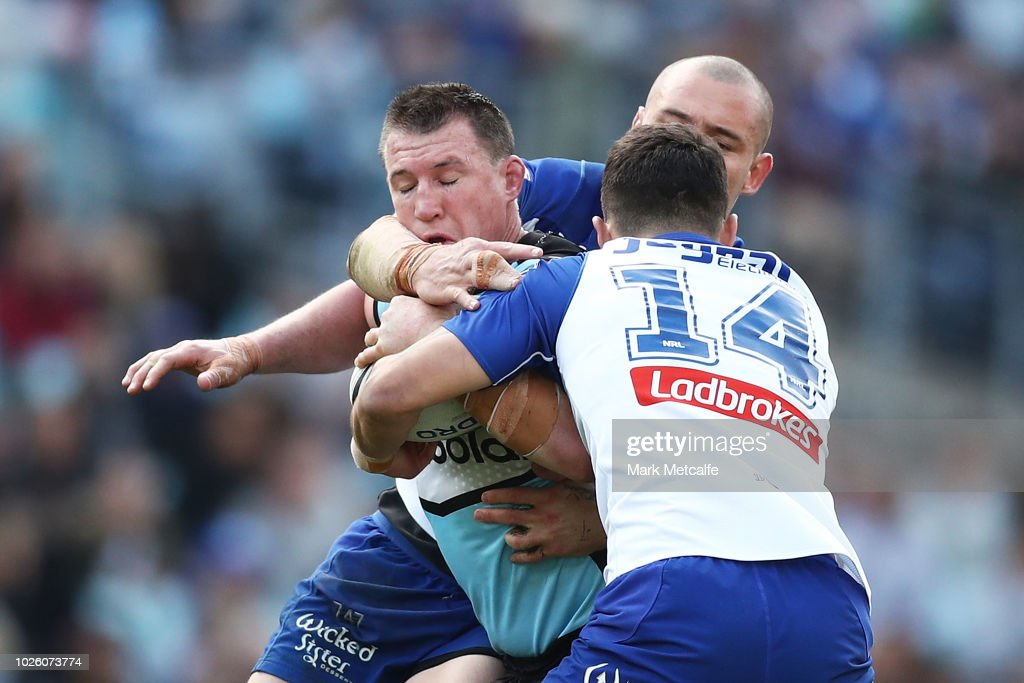 Paul Gallen of the Sharks is tackled by David Klemmer of the Bulldogs during the round 25 NRL match between the Canterbury Bulldogs and the Cronulla Sharks at ANZ Stadium on September 2, 2018 in Sydney, Australia.