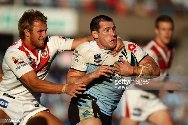 Paul Gallen of the Sharks is tackled by Matt Prior of the Dragons during the round 15 NRL match between the CronullaSutherland Sharks and the St...