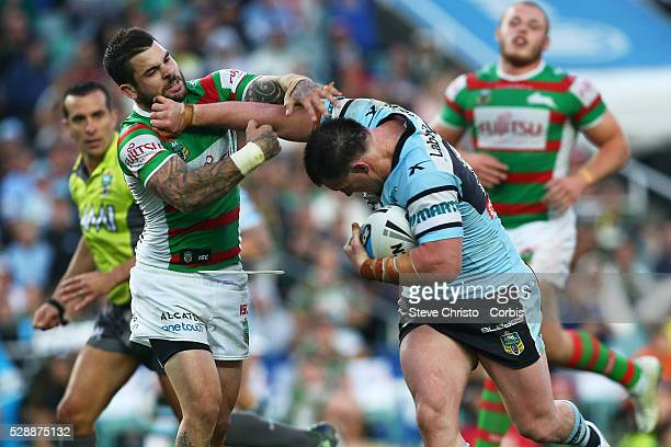 Paul Gallen of the Sharks is tackled by the Rabbitoh's Adam Reynolds during the Elimination Final match between South Sydney Rabbitohs and Cronulla...