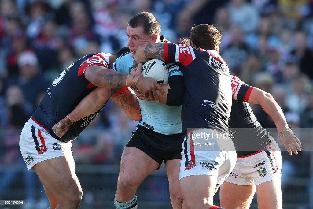 Paul Gallen of the Sharks is tackled by the Roosters defence during the round 17 NRL match between the Sydney Roosters and the Cronulla Sharks at Central Coast Stadium on July 1, 2017 in Gosford, Australia.