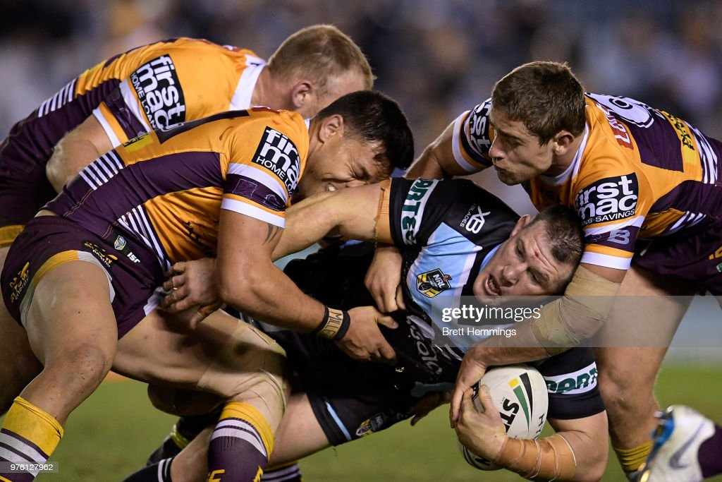 Paul Gallen of the Sharks is tackled during the round 15 NRL match between the Cronulla Sharks and the Brisbane Broncos at Southern Cross Group Stadium on June 16, 2018 in Sydney, Australia.
