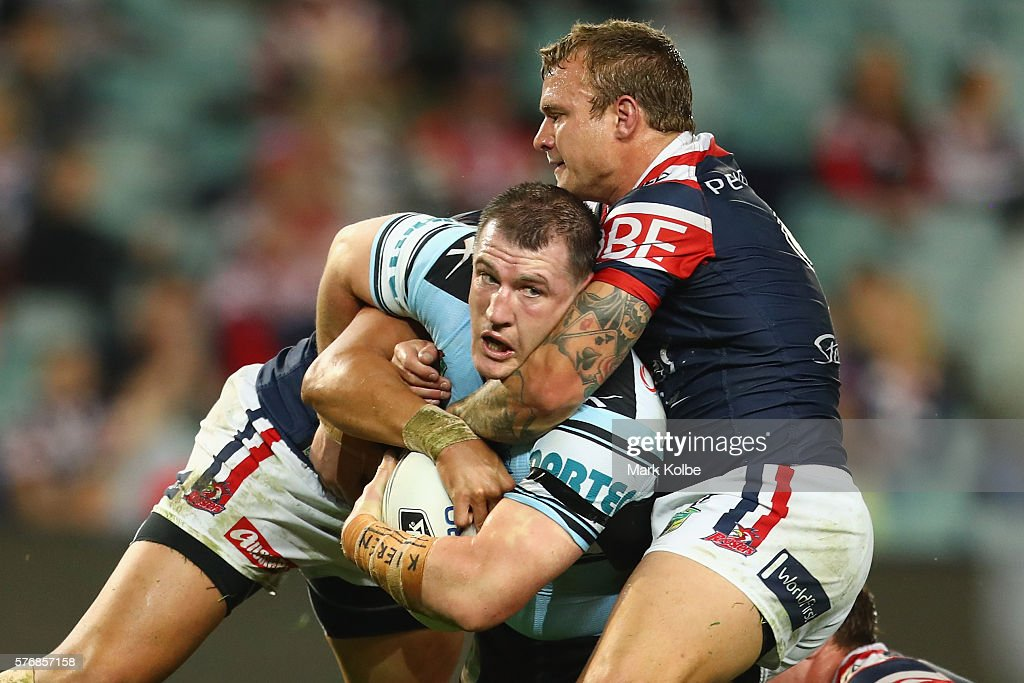 Paul Gallen of the Sharks is tackled during the round 19 NRL match between the Sydney Roosters and the Cronulla Sharks at Allianz Stadium on July 18, 2016 in Sydney, Australia.