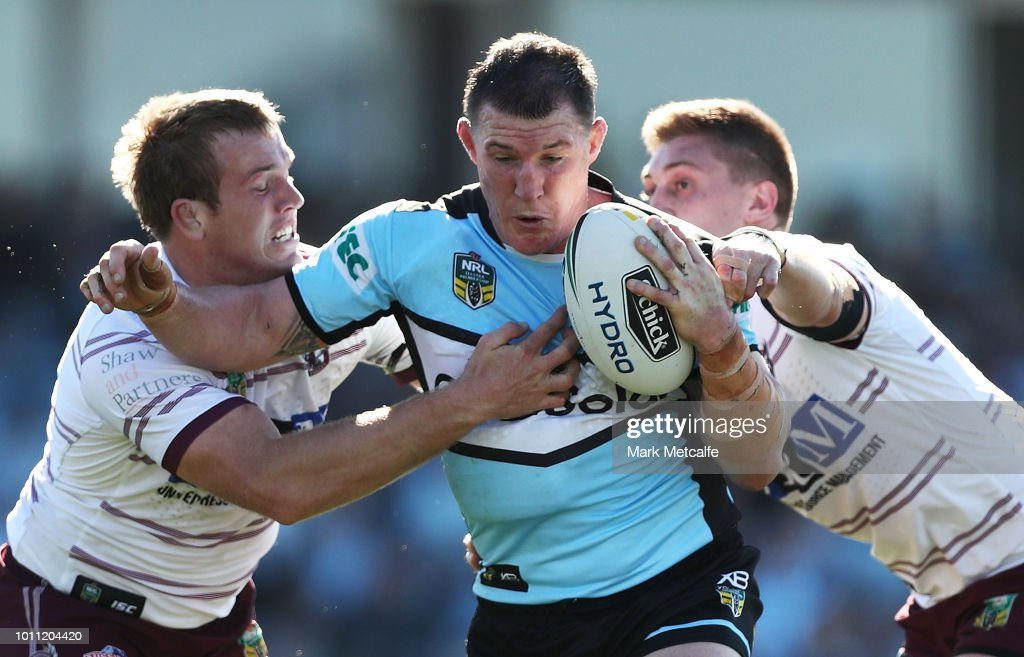 Paul Gallen of the Sharks is tackled during the round 21 NRL match between the Cronulla Sharks and the Manly Sea Eagles at Southern Cross Group Stadium on August 5, 2018 in Sydney, Australia.