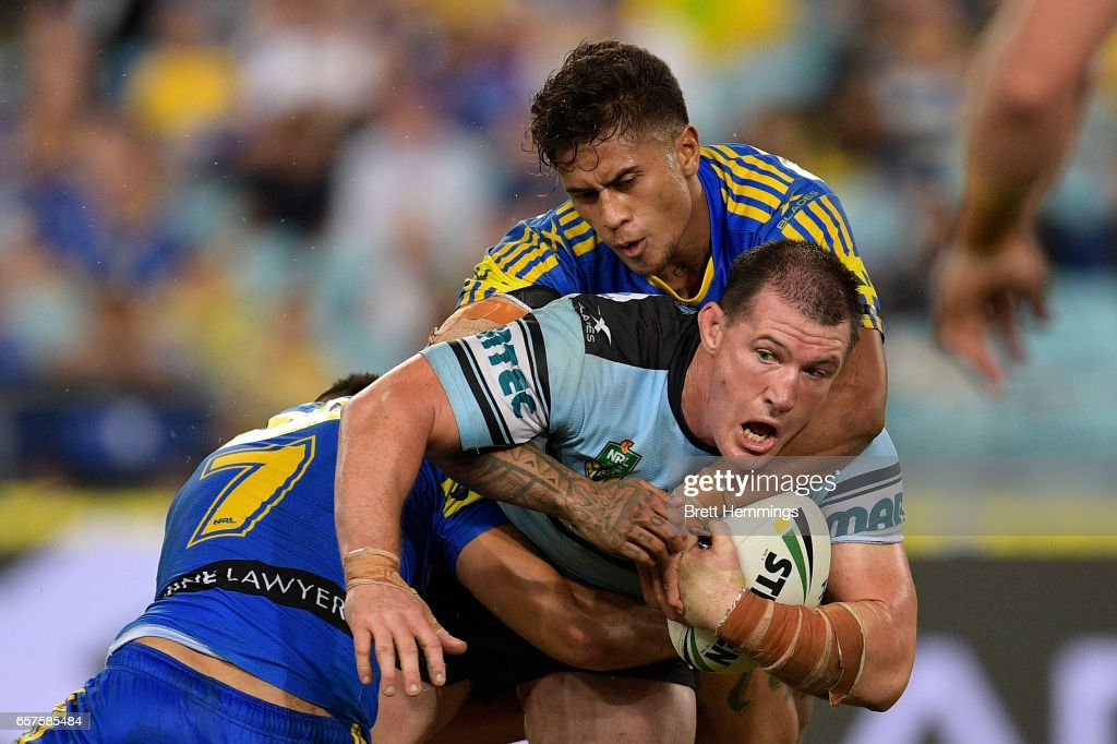 Paul Gallen of the Sharks is tackled during the round four NRL match between the Parramatta Eels and the Cronulla Sharks at ANZ Stadium on March 25, 2017 in Sydney, Australia.