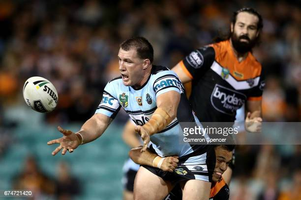 Paul Gallen of the Sharks is tackled during the round nine NRL match between the Wests Tigers and the Cronulla Sharks at Leichhardt Oval on April 29...