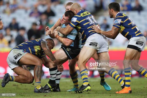 Paul Gallen of the Sharks is tackled during the round three NRL match between the Parramatta Eels and the Cronulla Sharks at ANZ Stadium on March 24...