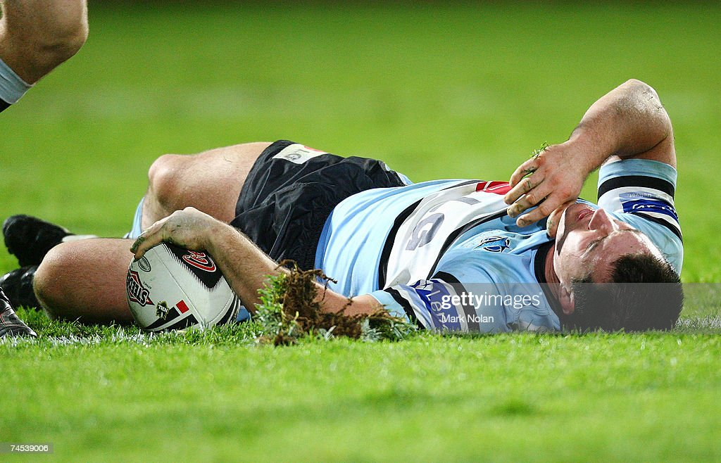 Paul Gallen of the Sharks lies down after a high tackle during the round 13 NRL match between the St George Illawarra Dragons and the Cronulla Sharks at OKI Jubilee Stadium June 11, 2007 in Sydney, Australia.