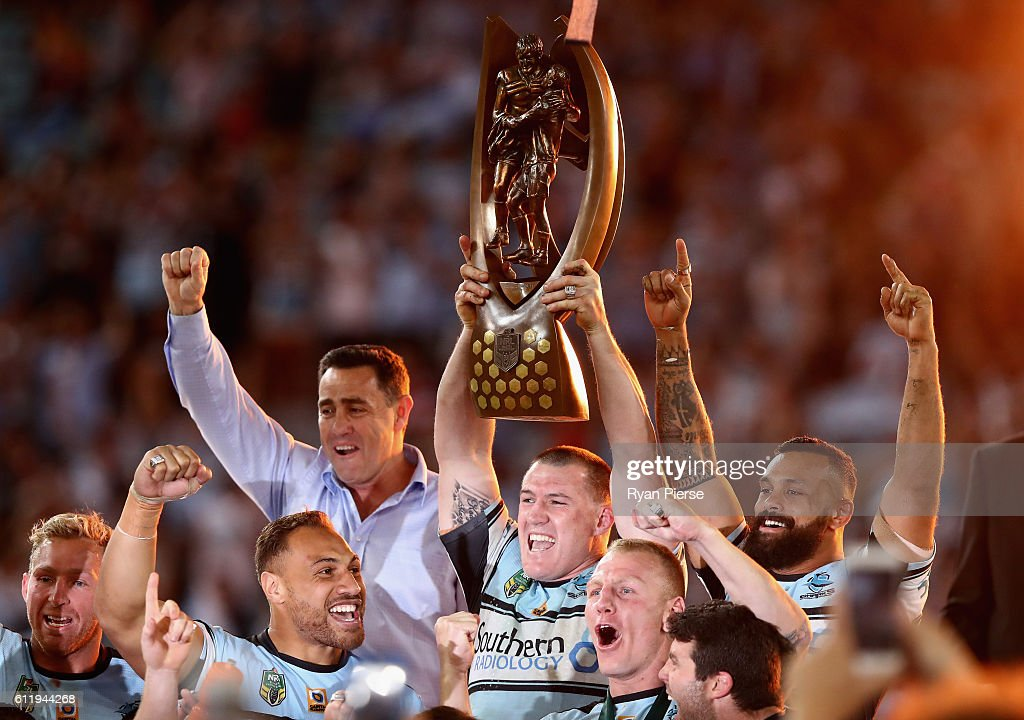 Paul Gallen of the Sharks lifts The Provan-Summons Trophy during the 2016 NRL Grand Final match between the Cronulla Sutherland Sharks and the Melbourne Storm at ANZ Stadium on October 2, 2016 in Sydney, Australia.