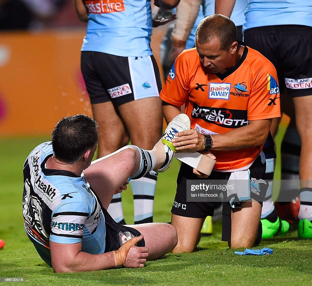 Paul Gallen of the Sharks receives treament for an injury during the Second NRL Semi Final match between the North Queensland Cowboys and the Cronulla Sharks at 1300SMILES Stadium on September 19, 2015 in Townsville, Australia.
