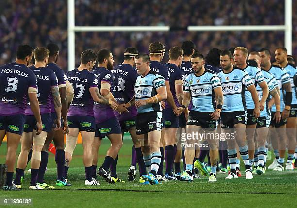 Paul Gallen of the Sharks shakes hands with Storm players before the 2016 NRL Grand Final match between the Cronulla Sutherland Sharks and the...