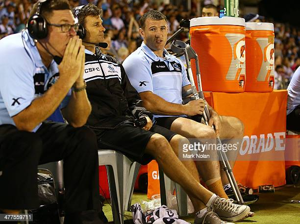 Paul Gallen of the Sharks sits on the bench after injuring his ankle during the round one NRL match between the Cronulla Sharks and the Gold Coast...